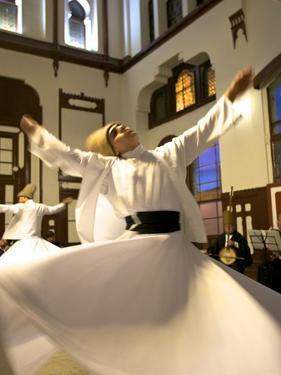 Whirling Dervishes, Istanbul, Turkey by Neil Farrin