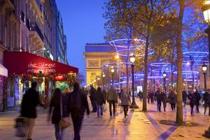 Xmas Decorations on Avenue Des Champs-Elysees with Arc De Triomphe in Background, Paris, France by Neil Farrin
