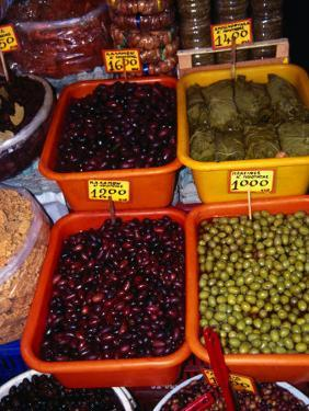 Olives and Stuffed Vine Leaves in Stall on 1866 Street, Iraklio, Greece by Neil Setchfield