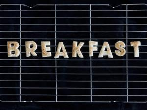 Toast Letters Spelling the Word Breakfast on a Rack by Neil Setchfield