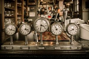 Vintage Clocks on a Bar Counter in a Pub by NejroN Photo