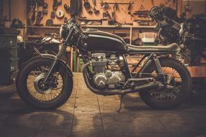 Vintage Style Cafe-Racer Motorcycle in Customs Garage by NejroN Photo