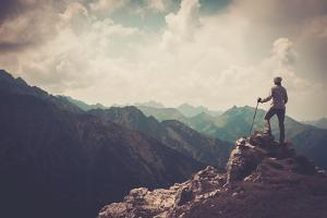 Woman Hiker on a Top of a Mountain by NejroN Photo