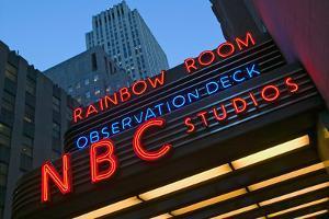 Neon lights of NBC Studios and Rainbow Room at Rockefeller Center, New York City, New York
