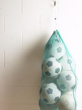Net of Soccer Balls on Gym Wall