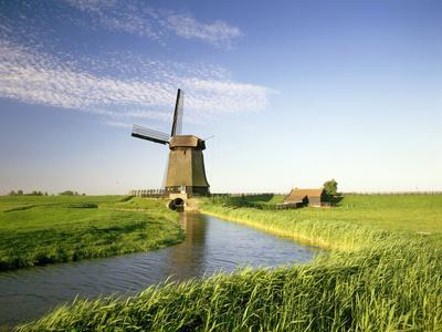 https://imgc.allpostersimages.com/img/posters/netherlands-polder-landscape-alkmaar-canal-windmill_u-L-Q11YHAZ0.jpg?p=0