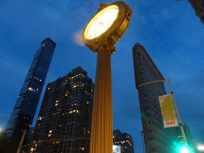 https://imgc.allpostersimages.com/img/posters/new-york-city-flatiron-district-with-old-clock-by-night_u-L-Q1EYEA20.jpg?artPerspective=n