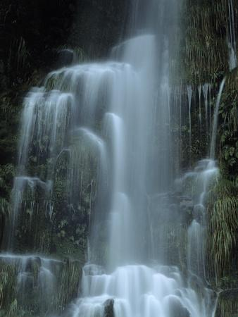 https://imgc.allpostersimages.com/img/posters/new-zealand-waterfall-in-the-valley-of-the-haast-river_u-L-Q11YOLG0.jpg?artPerspective=n