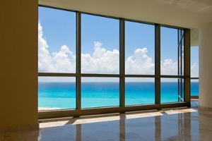 View of Tropical Beach Through Hotel Windows by nfsphoto