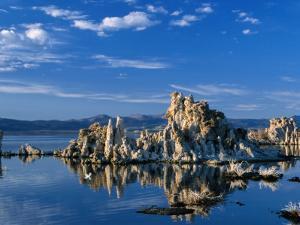 Tufa Outcrops Reflected in Lake, Eastern Sierra Nevada, Mono Lake, USA by Nicholas Pavloff