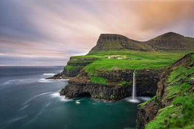 Gasadalur Village and its Iconic Waterfall, Vagar, Faroe Islands, Denmark. Long Exposure.