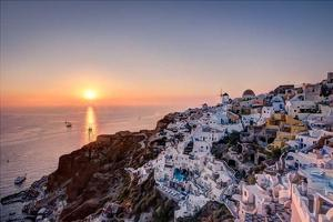 Sailing into the sunset, Oia, Greece by Nick Jackson