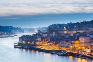 Portugal, Douro Litoral, Porto. Dusk in the UNESCO listed Ribeira district of Porto. by Nick Ledger