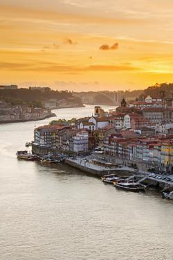 Portugal, Douro Litoral, Porto. Sunset over the UNESCO listed Ribeira district, viewed from Dom Lui by Nick Ledger