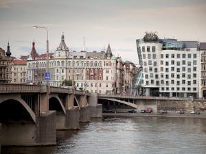 East Bank of Vltava River with Dancing House and Jiraskuv Bridge, Prague, Czech Republic by Nick Servian