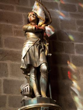 Statue of St. Joan of Arc with Coloured Light from Stained Glass, Church of Notre Dame, Vitre, Brit by Nick Servian