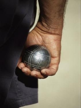 Bocce Bowler Holding a Ball by Nicole Duplaix