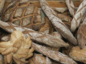 French Breads at a Bazaar in Provence by Nicole Duplaix