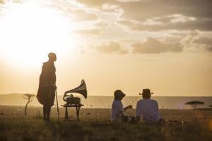 Kenya, Mara North Conservancy. a Couple Enjoy a Sundowner in the Mara by Niels Van Gijn