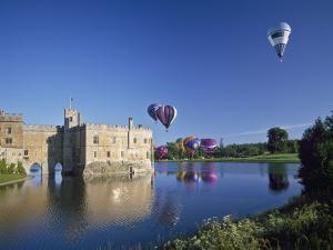 Hot Air Balloons Taking Off from Leeds Castle Grounds, Kent, England, United Kingdom, Europe by Nigel Blythe