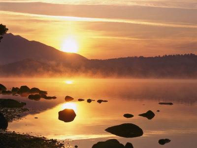 Mist Rising on Derwent Water at Sunrise, Lake District National Park, Cumbria, England, UK