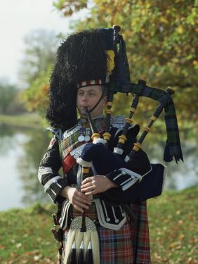 Bagpiper, Scotland, United Kingdom, Europe by Nigel Francis