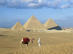 Camel Rider at Giza Pyramids, Giza, Cairo, Egypt, Africa by Nigel Francis