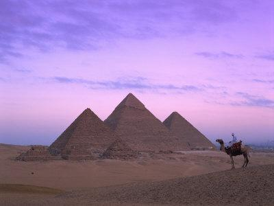 Camel Rider at Giza Pyramids, Giza, UNESCO World Heritage Site, Cairo, Egypt, North Africa, Africa
