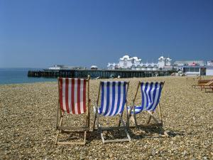 Empty Deck Chairs on the Beach and the Southsea Pier, Southsea, Hampshire, England, United Kingdom by Nigel Francis