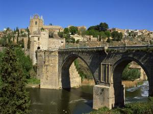 Old Gateway Bridge over the River and the City of Toledo, Castilla La Mancha, Spain, Europe by Nigel Francis
