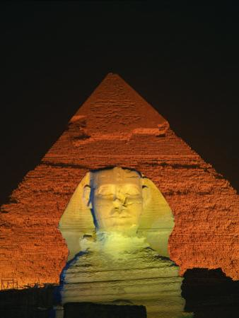 Sphinx and One of the Pyramids Illuminated at Night, Giza, Cairo, Egypt