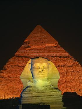 Sphinx and One of the Pyramids Illuminated at Night, Giza, Cairo, Egypt by Nigel Francis