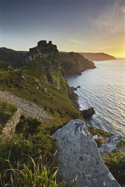 A Sunset View of the Cliffs at the Valley of Rocks, Lynton, Exmoor National Park, Devon by Nigel Hicks