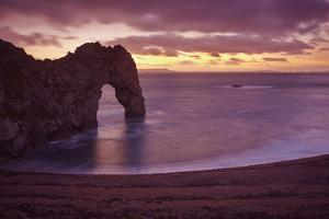 The Durdle Door Rock Arch at Dusk by Nigel Hicks