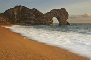 The Durdle Door Rock Arch at Sunset by Nigel Hicks