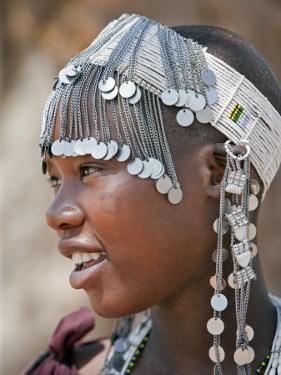 A Maasai Girl from the Kisongo Clan Wearing an Attractive Beaded Headband by Nigel Pavitt