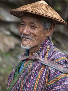 A Wizened Old Farmer Near Mongar Wears the Traditional Knee-Length National Robe Called Gho and a B by Nigel Pavitt