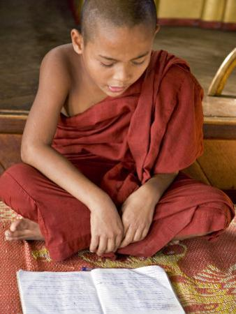 Burma, Lake Inle, A Young Novice Monk Learning at a Monastery School on Lake Inle, Myanmar