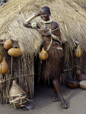 Datoga Woman Relaxes Outside Her Thatched House, Tanzania by Nigel Pavitt