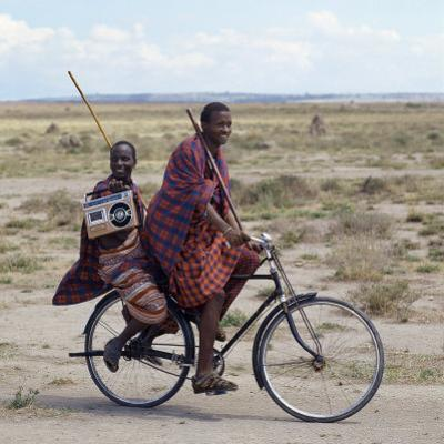 Despite their Traditional Dress, Two Young Maasai Give Hints That Lifestyle Is Changing in Tanzania by Nigel Pavitt