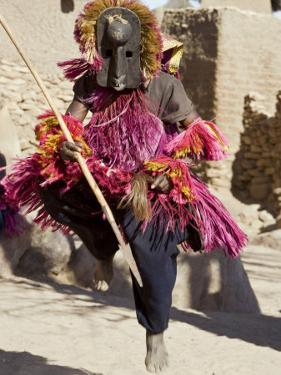 Dogon Country, Tereli, A Masked Dancer Leaps High in the Air at the Dogon Village of Tereli, Mali by Nigel Pavitt