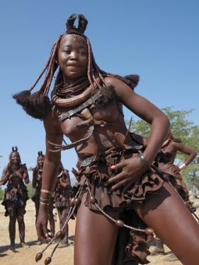 Himba Women Perform the Otjiunda Dance, Stamping, Clapping and Chanting by Nigel Pavitt