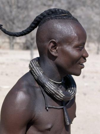 Himba Youth Has His Hair Styled in a Long Plait, known as Ondatu, Namibia