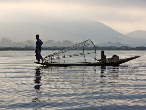 Intha Fisherman with Traditional Fish Trap, Unusual Leg-Rowing Technique, Lake Inle, Myanmar by Nigel Pavitt
