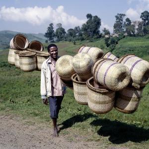Man Carries Traditional Split-Bamboo Baskets to Sell at Kisoro Market, Southwest Uganda by Nigel Pavitt