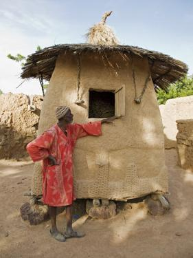 Mopti, A Bobo Man Beside His Millet Granary at a Bobo Village Near Mopti, Mali by Nigel Pavitt