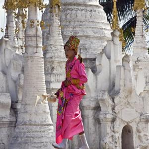 Myanmar, Burma, Lake Inle, A Young Novitiate Passes an Ornate Buddhist Shrine by Nigel Pavitt