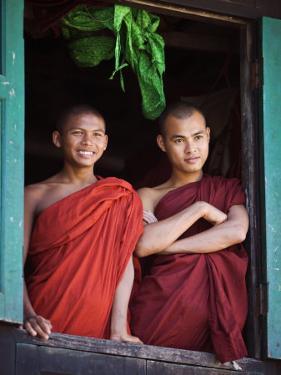 Novice Monk with Food Bowl and Utensils at Pathain Monastery, Sittwe, Burma, Myanmar by Nigel Pavitt