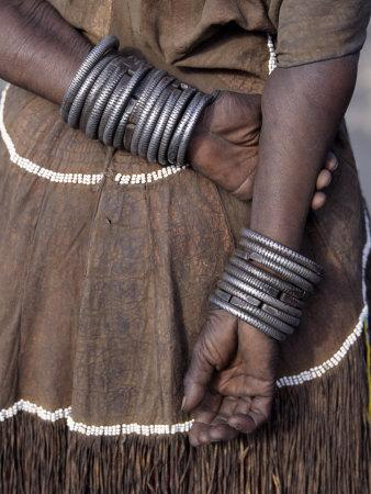 Numerous Decorated Iron Bracelets Worn by a Datoga Woman, Tanzania