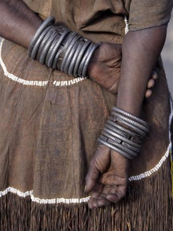 Numerous Decorated Iron Bracelets Worn by a Datoga Woman, Tanzania